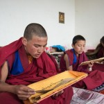 Monks learn Tibetan at Qamdo Monastery in Jinchuan County, southwest China's Sichuan Province, June 25, 2014. The Tibetan Buddhism monastery is located at an altitude of 2,000 meters in Sichuan and has been at least 1,000 years old.