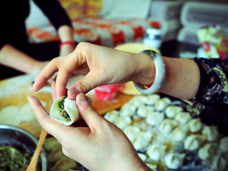 Making dumplings on Tibetan New Year's Eve