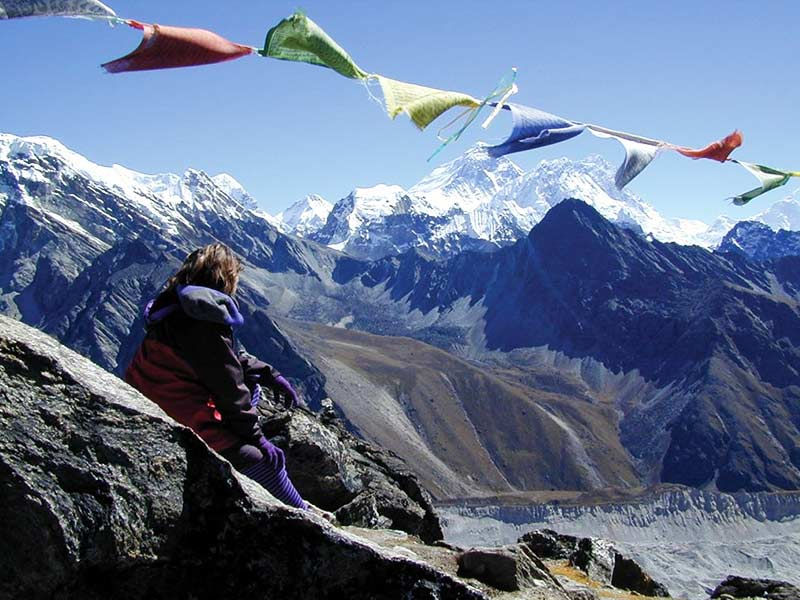 By putting the flags high up in the peaks the Lung Ta will travel to spread good luck to all.