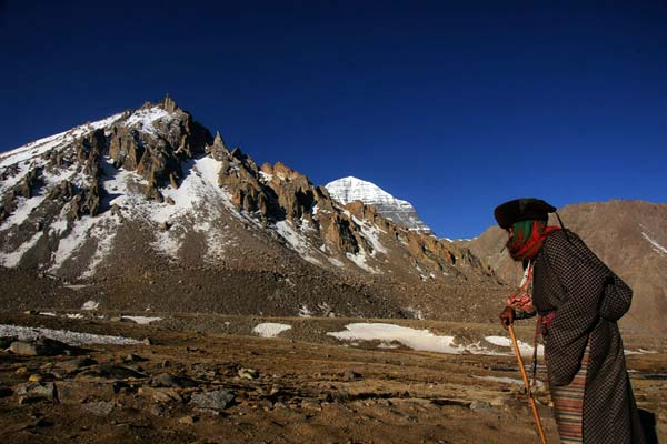 You may meet local pilgrim while trekking circuit around Mount Kailash.