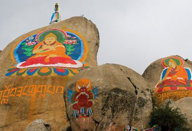 The murals of Buddha and its protector in Drepung monastery