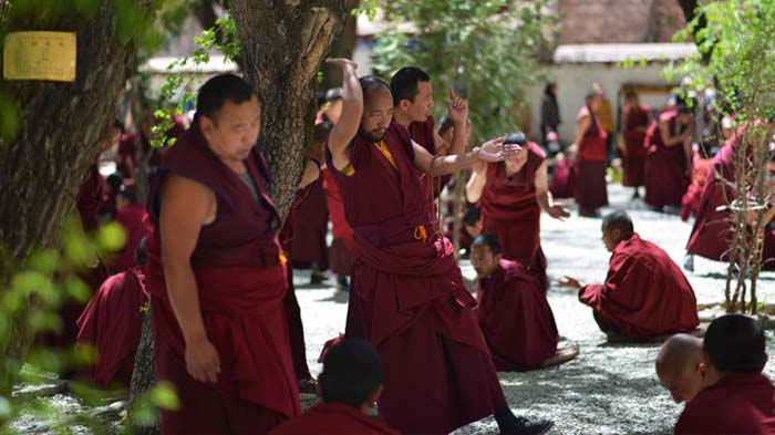 Monk debate held  in the courtyard of Sera monastery