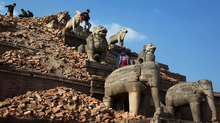 Tourists ascend the damaged site of Nyatapola temple in Bhaktapur city