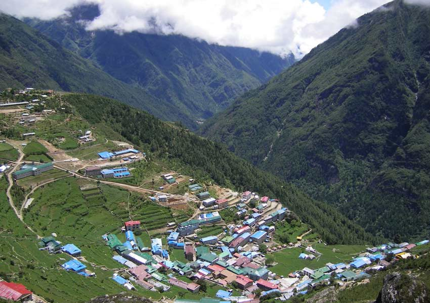 Namche Bazaar village is located on crescent shaped mountain slopes that offer stunning views of the mountains across the valley.