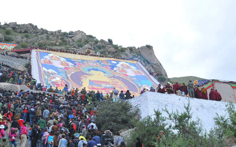 Tibet, Giant Buddha showing on Shoton Festival 2018 received world-wide followers' worships at Drepung