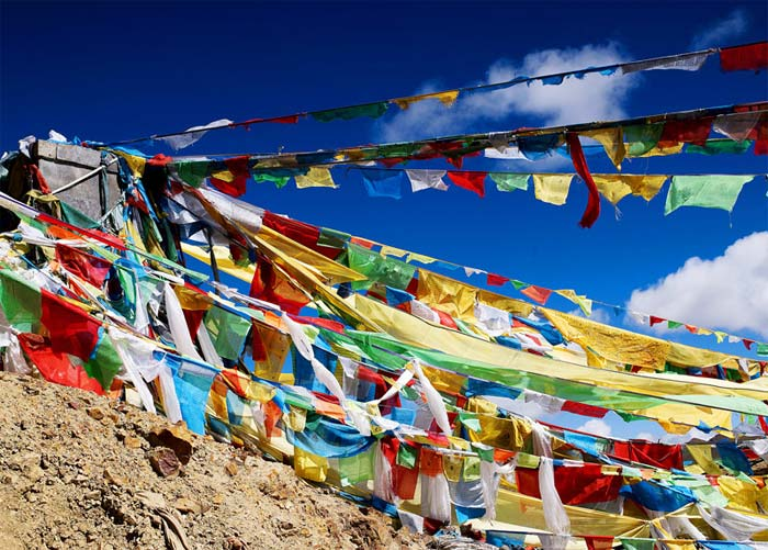 Prayer flags at Mila Mountain Pass for increasing happiness and good fortune among all living beings.